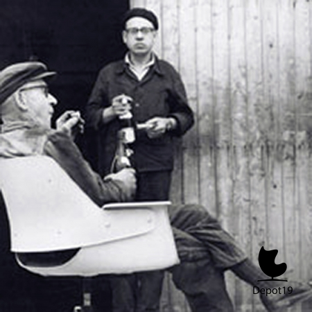 Lunch_break_in_the_workshop_with_bread_and_beer_and_a_prototype_of_the_240_model_1954.jpg